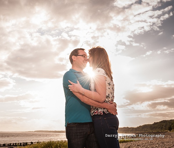 outdoor shoot at the beach with engaged couple near sunset