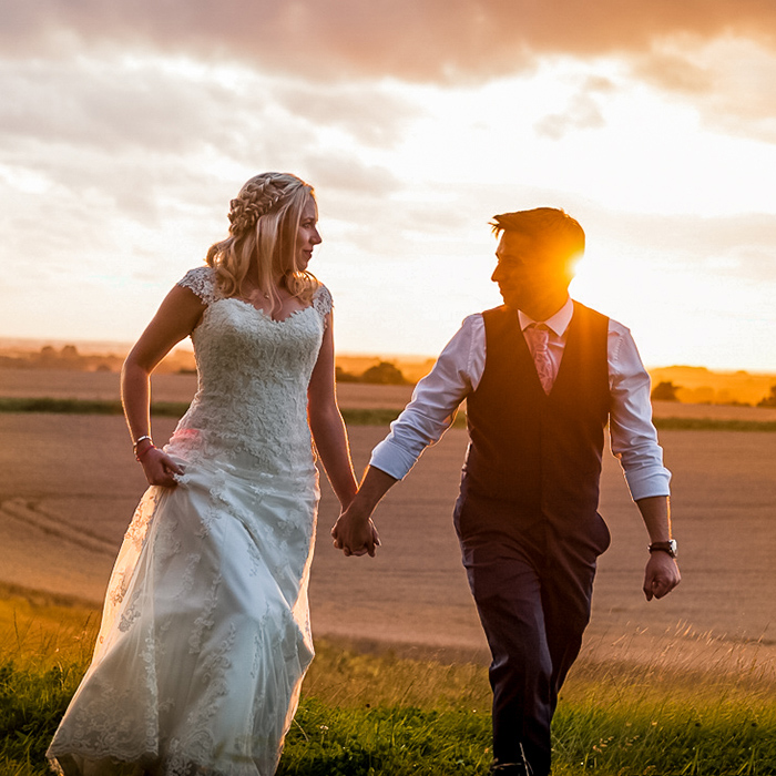 romantic wedding couple holding hands at sunset  East Yorkshire